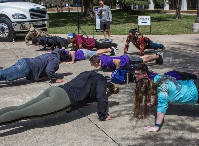South students participate in the 22-pushup challenge to raise awareness about veteran suicide prevention during South's community resources event. The challenge represents how many veterans commit suicide every day.