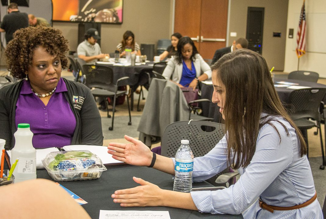 Student accessibility resources coordinator Kimele Carter listens to Brooke Lopez at TR Campus' Writing Your Leadership Legacy event April 13.