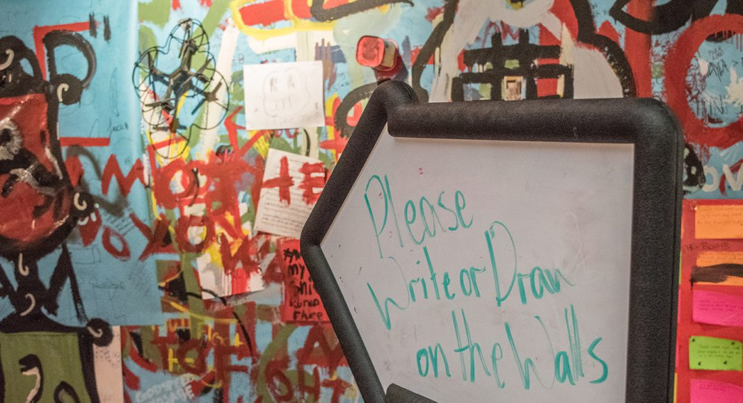 The walls are lined with paper to allow students to paint and draw in an open form of expression April 2-5 in NW's Lakeview Gallery. Paint, duct tape and nontraditional materials were available to students for self-expression.