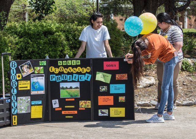 South students Salma Cordoba, Leslie Villegas and Jenny Ruiz inform others about the ecosystem project at the Earth Day celebration April 18.