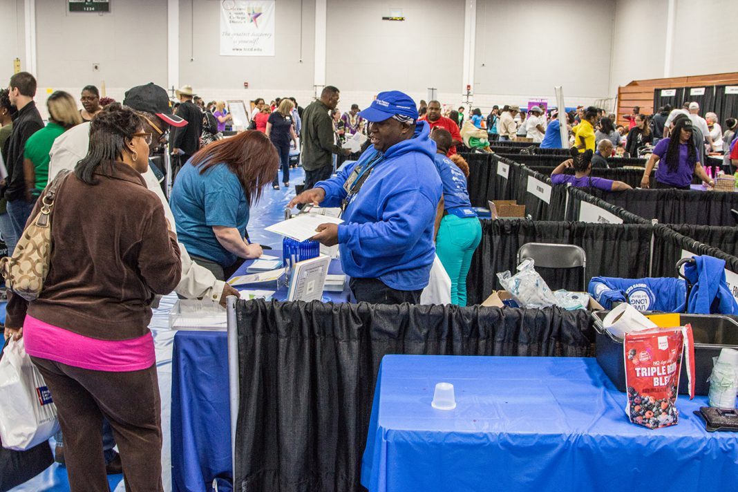 Despite the rain, community members flooded into South Campus' gym to learn more about health, receive free screenings and learn how to cook healthy meals April 21.