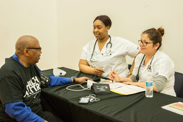 Attendees get their blood pressure checked and learn their kidney function during the African-American Health Expo April 21 on South Campus.