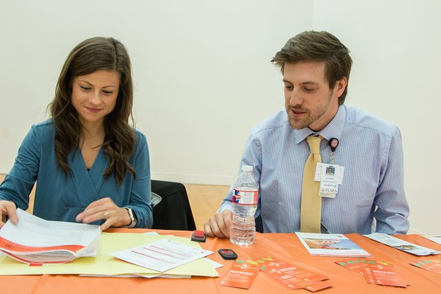 Registered dietitian Jeri Bright and physician Tim Dobin look over information during the health expo on South. Medical professionals were on hand to give health advice.
