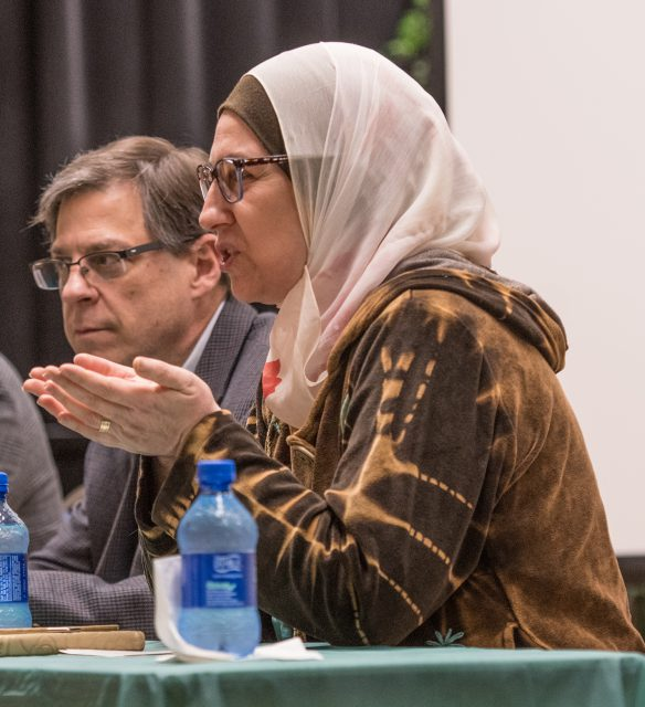 TCU faculty member Dina Maliki speaks on the panel. She was born into an interfaith family and is Muslim.