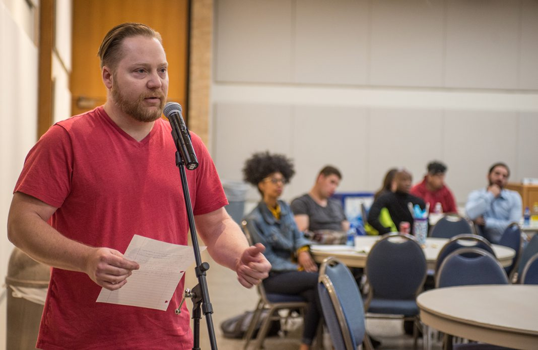 NE student Jason Gardner asks about how inclusivity affects the panel's respective religions at the talk April 2.