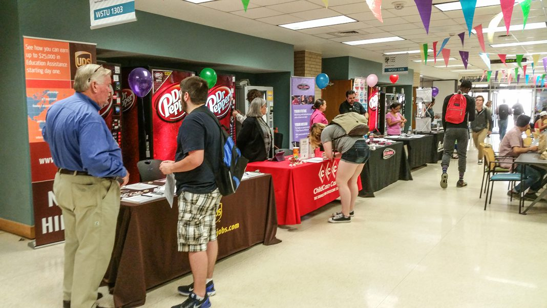 Students talk to employers to find out more about job opportunities at a 2015 job fair on NW Campus. The Cinco de Mayo Job Fair will be held from 10 a.m.-2 p.m. May 2 in WSTU 1303 and 1305 and will feature over 40 employers.