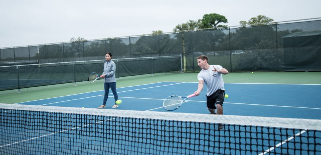 NE students and Tennis Club members Khanh Tran and David Schwartz practice April 2 on NE Campus in preparation for their trip to the national tournament April 12-14 in Orlando, Florida.