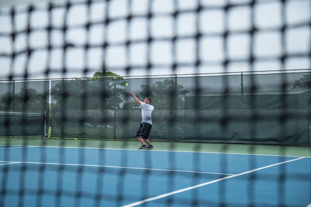 NE student David Schwartz serves during practice before the NE Tennis Club travels to the Tennis On Campus National Championship.