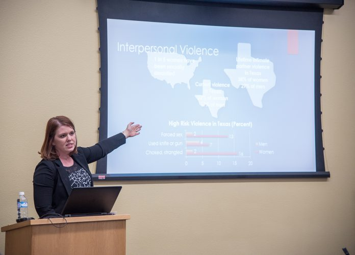 TESSA program manager Jessica Grace addresses SE students April 18. Her speech focused on the long-term effects of violence.