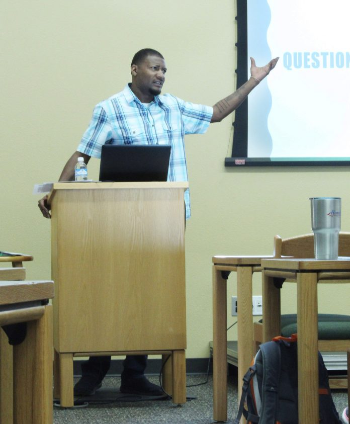 SE English instructor Arlandis Jones speaks about graphic arts and its influence March 22 on SE Campus.