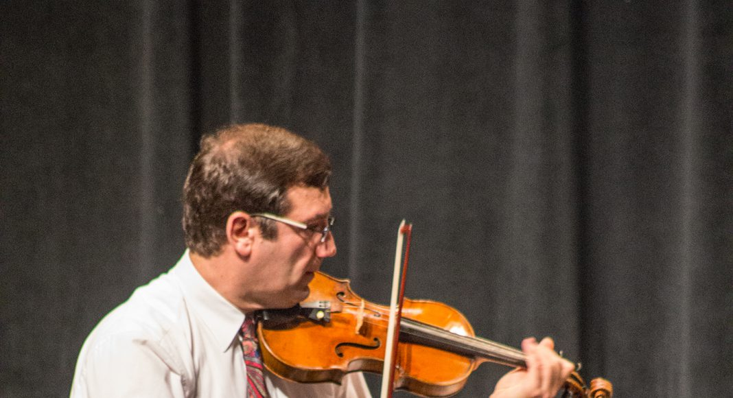 Yellow Rose Trio violinist Ivo Ivanov is a Bulgaria native and an adjunct violin instructor on SE Campus.