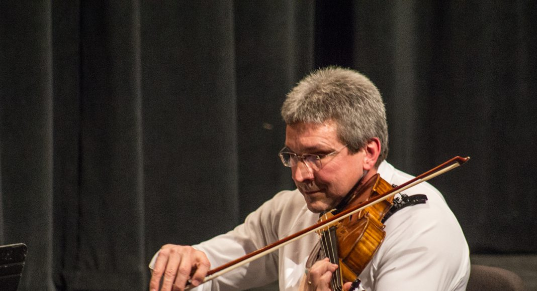 Classical violist Thomas Demer is also a successful fiddler and tenor banjo player.