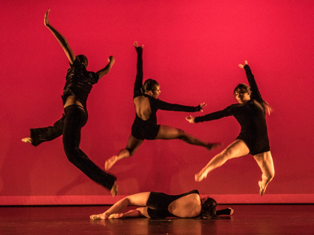"Guest choreographer Gregory Neyland performs ""Rise of Power"" with Haltom High School dance students during NW's student choreography showcase April 26."