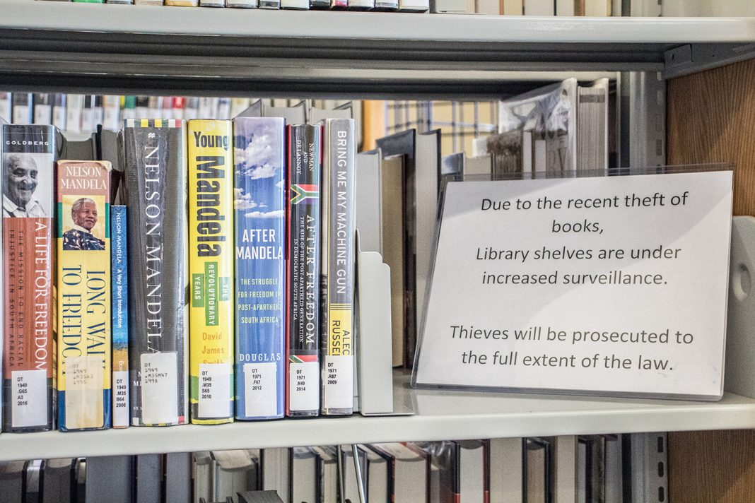 For the last two years, signs notifying students of camera surveillance sit on the bookshelves at SE Campus' Judith Carrier Library. Campus police have access to the footage.
