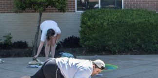 SE student Carlos Martinez participates in Chalk the Walk April 26 on SE Campus. Martinez assisted SE student Diana Avila to complete their section of the walk.