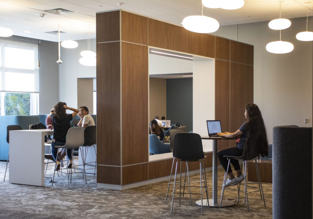 SE students study and socialize between classes Aug. 27 in the new learning commons area that connects the second floors of the campus' ESCT and ESEE buildings.