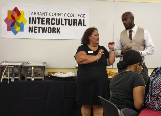 TR financial aid specialist Stephanie Castillo chats with TR intercultural student engagement coordinator Dantrayl Smith during the open house Aug. 23 on TR.