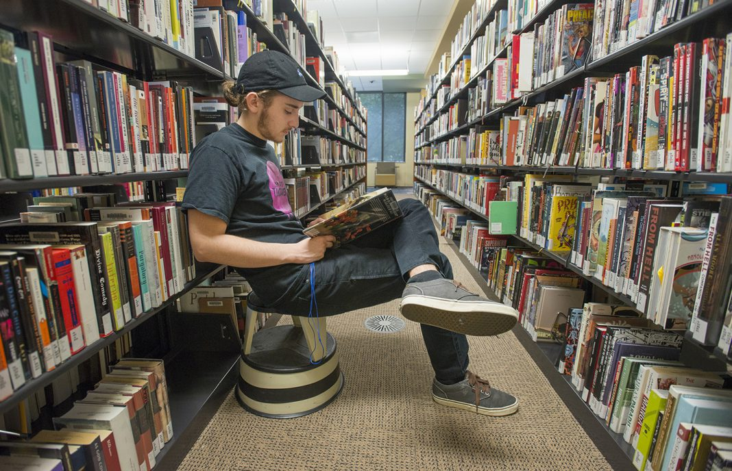 NW student Ashton Hinrjos passes time before his next class by sitting and reading in the TR library. TCC's libraries provide students with a range of services.