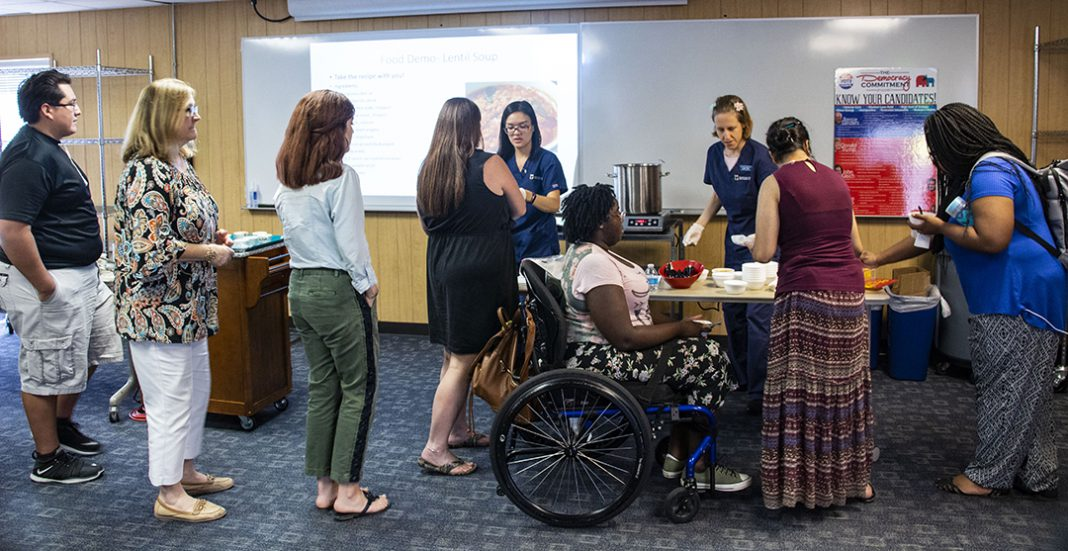 SE dietician intern Linda O'Dell and her proctor Amy Wan serve the lentil soup they made during the demonstration of healthy cooking on a budget Sept. 19 in SE's food pantry.