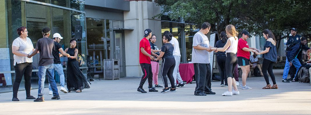 TR students practice steps to the bachata they learned during TR's Noche de Salsa event Sept. 19 in the campus courtyard. Students also learned to salsa during the Hispanic Heritage Month event.
