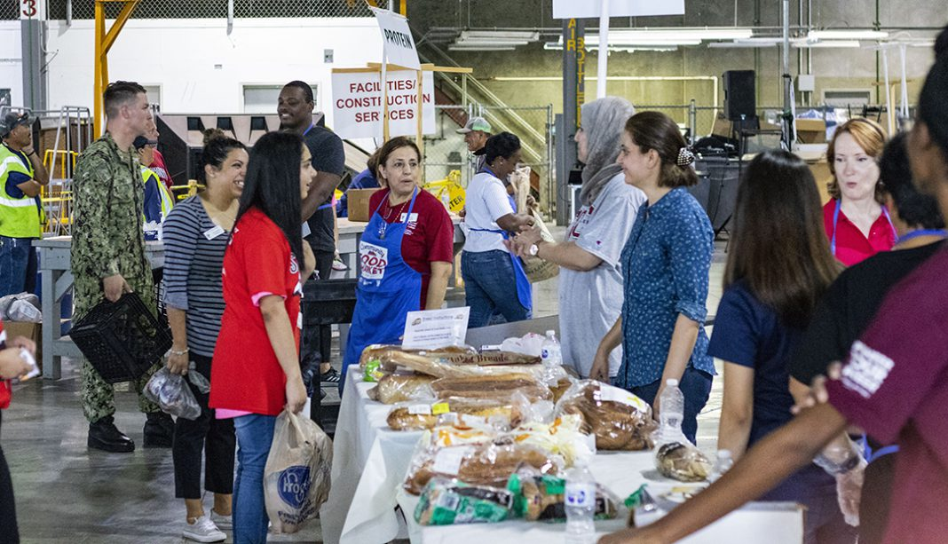 NW Campus volunteers hand out bread, vegetables and other goods to local residents at the Community Food Market Sept. 21 on NW.