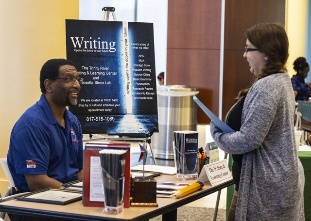 TR learning center coordinator Steven LeMons discusses writing opportunities with TR student Marietta Huaute Aug. 29.