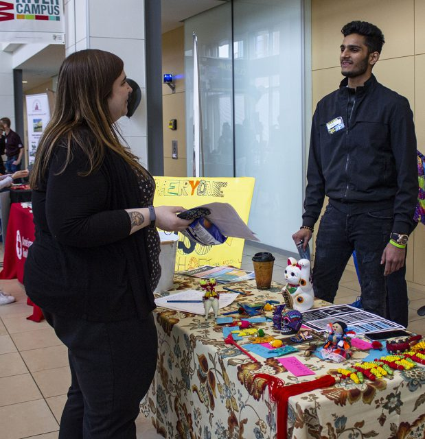 TR student and International Student Association club president Steven Eric talks to academic success coach Christina Liner about his organization during Club Crawl Sept. 6 on TR Campus.