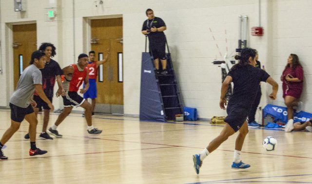 A Bucees player attempts to intercept the ball as Drip Season players look to connect with their forward up the field. The teams faced off in the second semi-final game of the tournament.