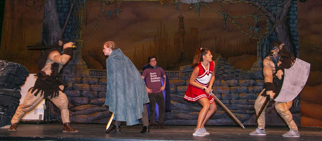 NW student Lauren Smith, as Tillius the Paladin, and NW student Jesse Martinez, as Agnes, fight against foes on stage. She Kills Monsters will run Oct. 3-7 in Theatre Northwest.