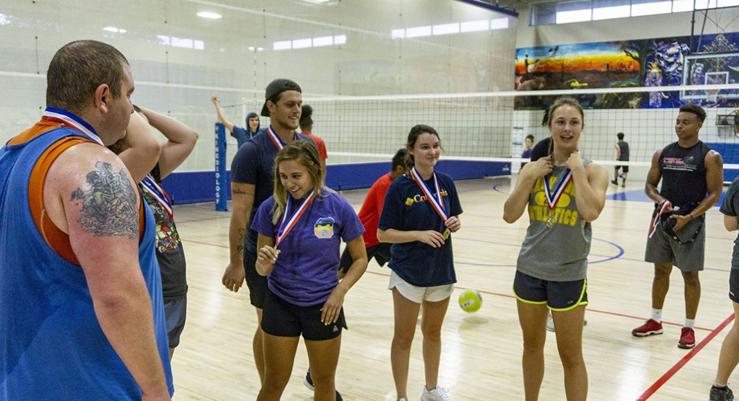 CV Squad team members receive medals for defeating the rest of the competition in intramural volleyball. The team went undefeated through the bracket.
