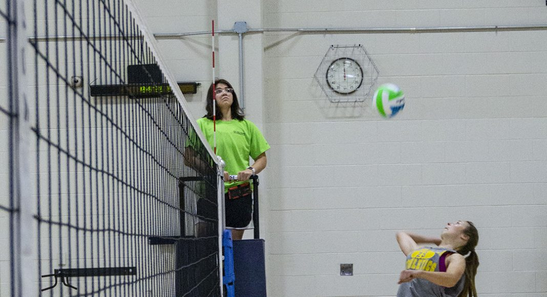 NW student Lauren Rose looks to crush the ball with a spike. Rose was one of the six members of the winning team during the intramural volleyball tournament.
