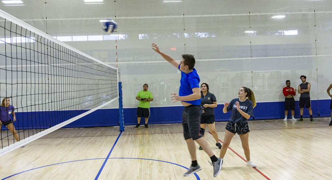 The ball is sent back over the net by a NW student while his teammates stay ready during intramural volleyball. Intramurals are free for TCC students, faculty and staff.