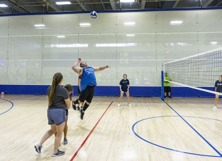 NW student Hans Reeves lines up to spike the volleyball during NW's intramural volleyball tournament Sept. 6. Most campuses offer different intramural sports during the semester.