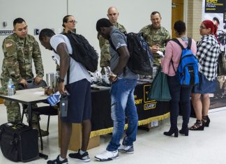 NW students and community members find out information about the U.S. Army at the NW Military Career Fair Sept. 12. All branches of the military had tables set up during the event.