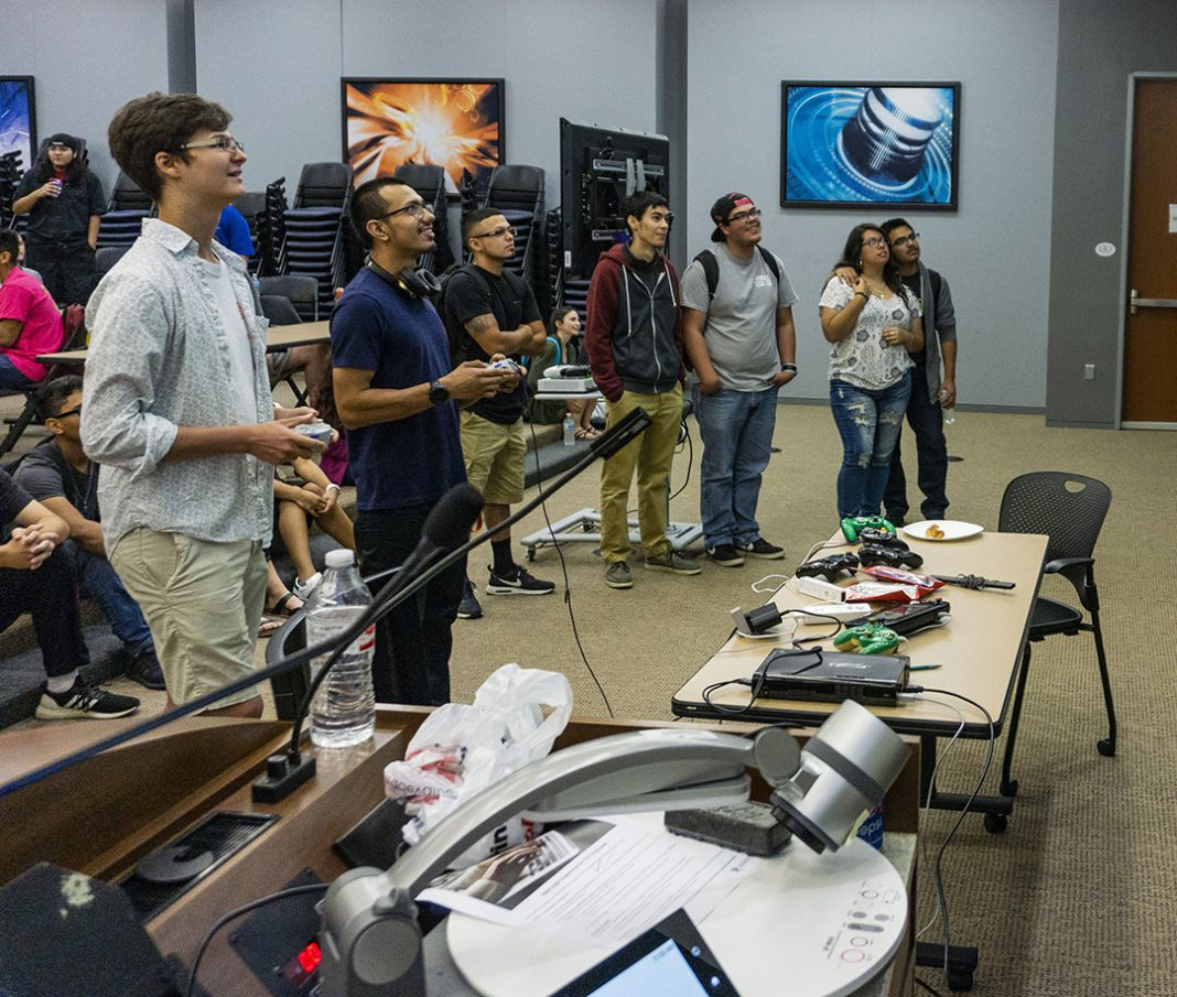 TR students James Cottle and Ramiro Donjuan battle it out in the Super Smash Bros. 4 tournament Sept. 20 at Games for Change in the Energy Auditorium on TR. Tournaments for five different games were held at the event.