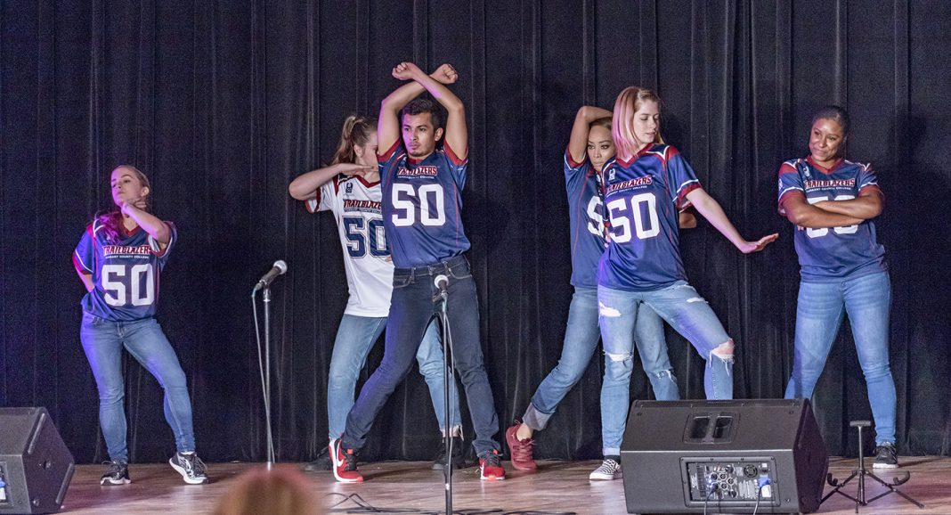 NE Campus' Movers Unlimited dance company kicks off Harmony with a performance celebrating different dances from each decade of the campus' 50-year history. Harmony was one of several homecoming events that took place Oct. 16-18 to celebrate NE Campus' golden anniversary.
