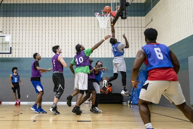 SE student Cecil Roberts of Buckets 2.0 goes for a layup against TCC Underdogs in the semifinals.