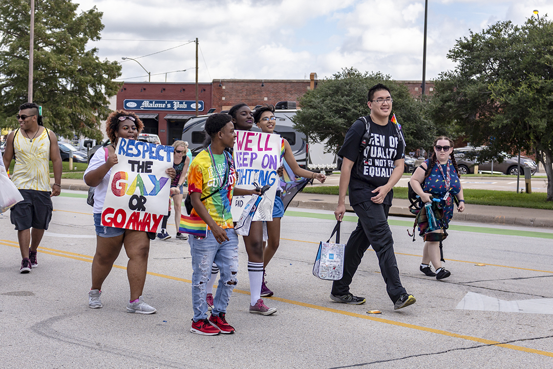 South student and Spectrum club president Miracle Stokes marches with fellow TCC students from other LGBTQ organizations around the district.