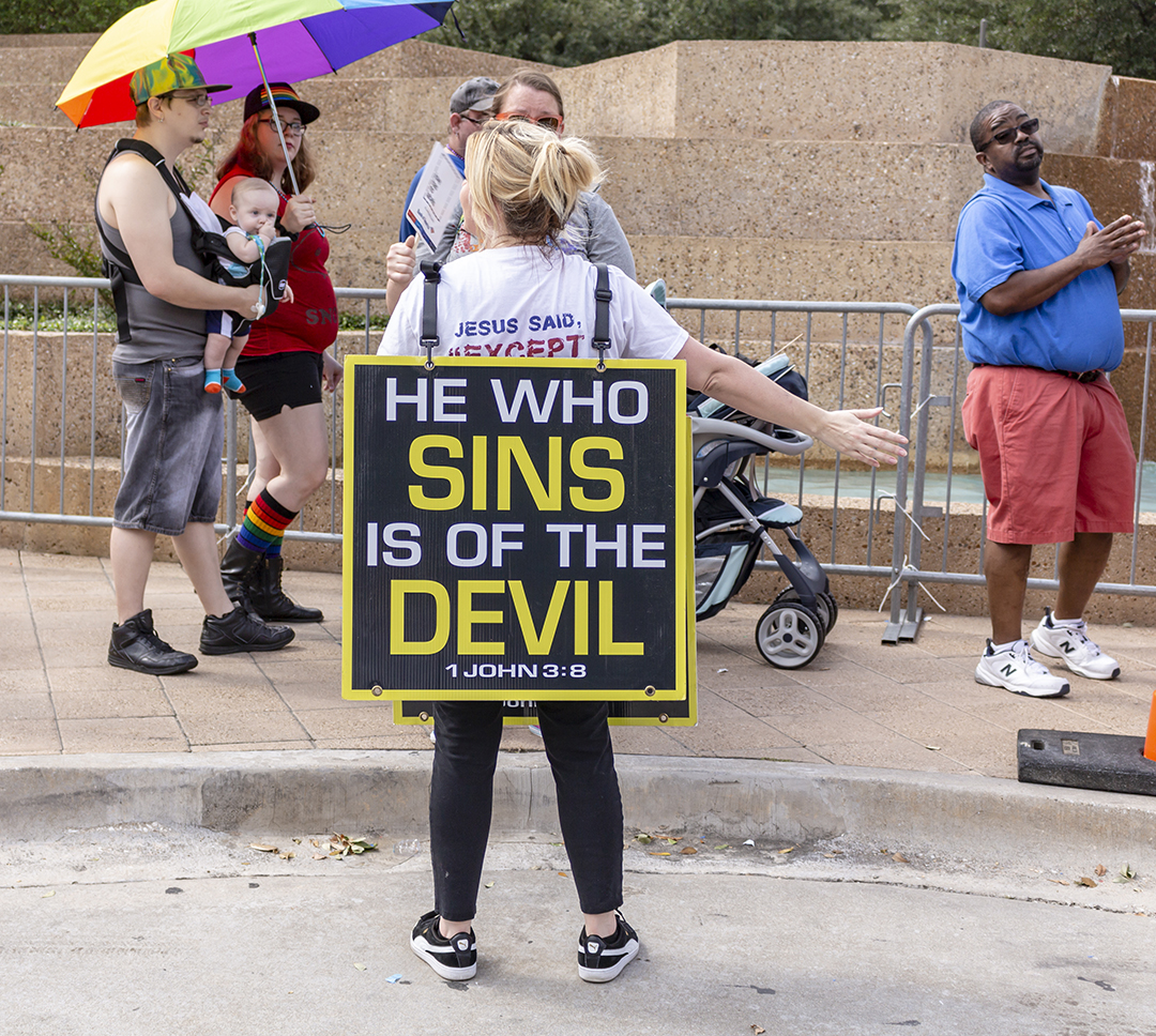 Tarrant County resident Kristi, who chose not to give her name, protests after the Tarrant County Pride Parade as attendees head to the Pride Festival Oct. 6.