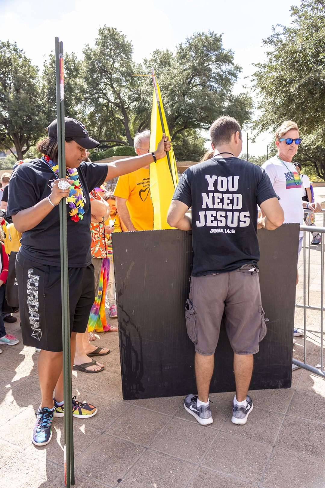 DFW Sisters of Perpetual Indulgence member Ashley Bobb blocks a protester.