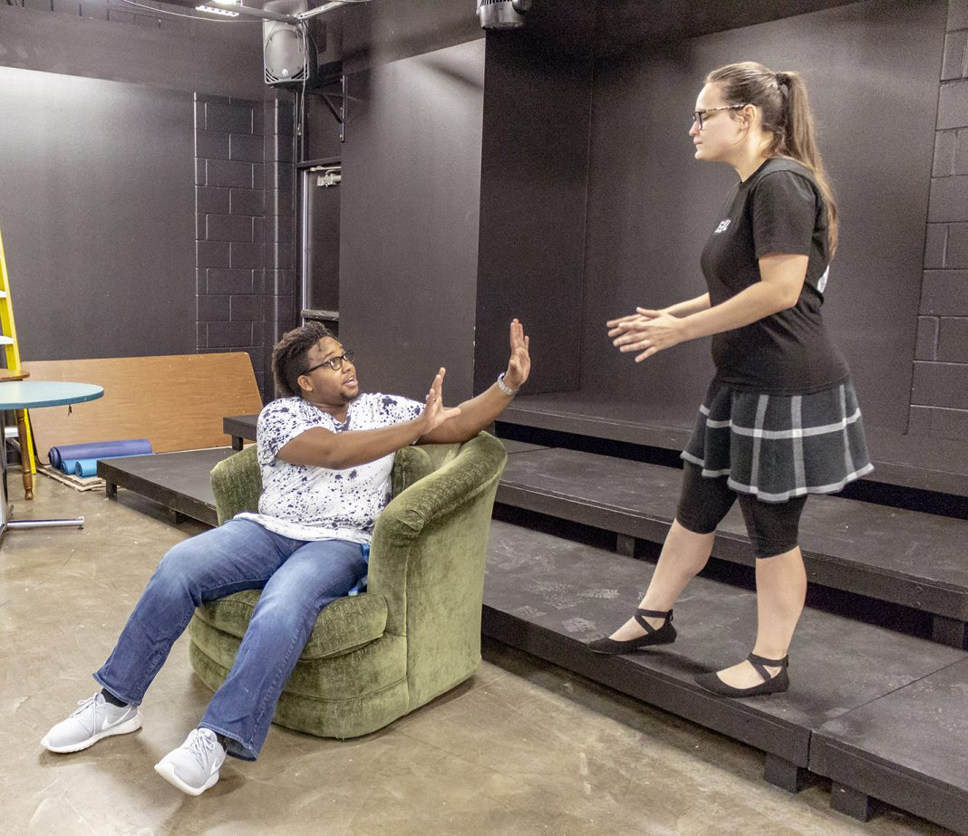 SE students Rickie Jones, who plays Agent Aries, and Courtney Berry, who plays Agent Artemis, rehearse a scene in Out of Time, one of five plays that will be performed during the Festival of New Plays Nov. 7-10 on SE.