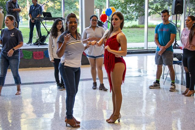 Dance instructors teach students steps to traditional Latin dances at Salsa y Salsa Sept. 27 on South. Attendees listened and danced to live music while learning various styles.