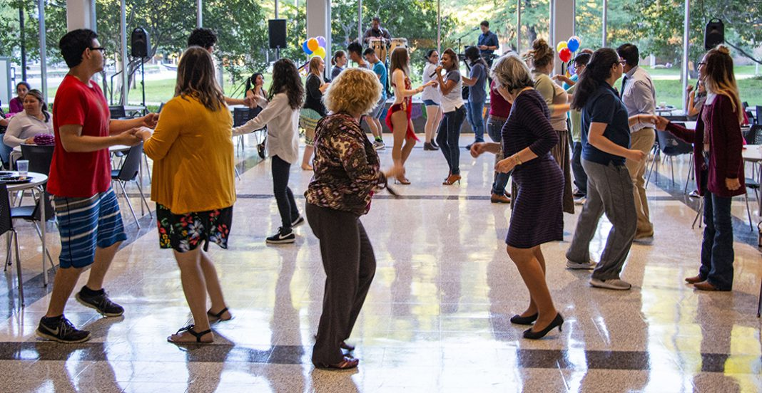 Students dance to live music at Salsa y Salsa Sept. 27 in the SSTU patio on South Campus. Attendees received free dance lessons and learned how to salsa, merengue and bachata.