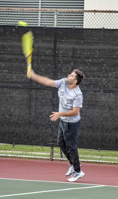 A NW student lines up his shot for a serve during intramural tennis Oct. 11 on NW Campus.