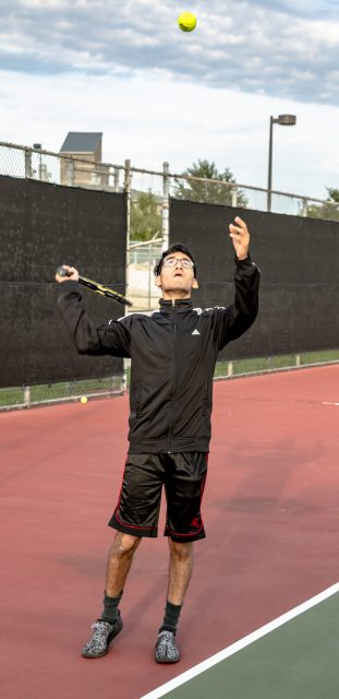NW student Joan Vargas tosses the ball in the air for a serve during NW intramural tennis. Students can play intramural sports for free. The next NW events are football 3:30-7 p.m. Oct. 24 and the Toro Dash at 8 a.m. Nov. 3.
