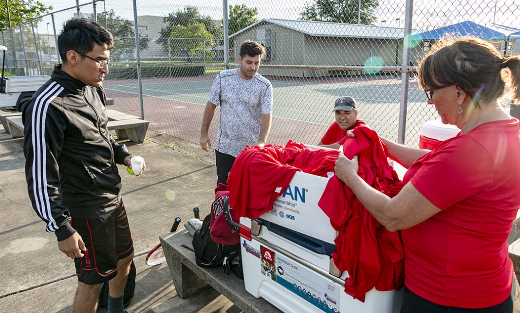 Karin Davidson from the NW Tennis Club hands out shirts to everyone who participated in the intramural tennis tournament Oct. 11 on NW Campus. Intramurals cycle through different sports throughout the semester, and students can contact their campus kinesiology department for upcoming events.