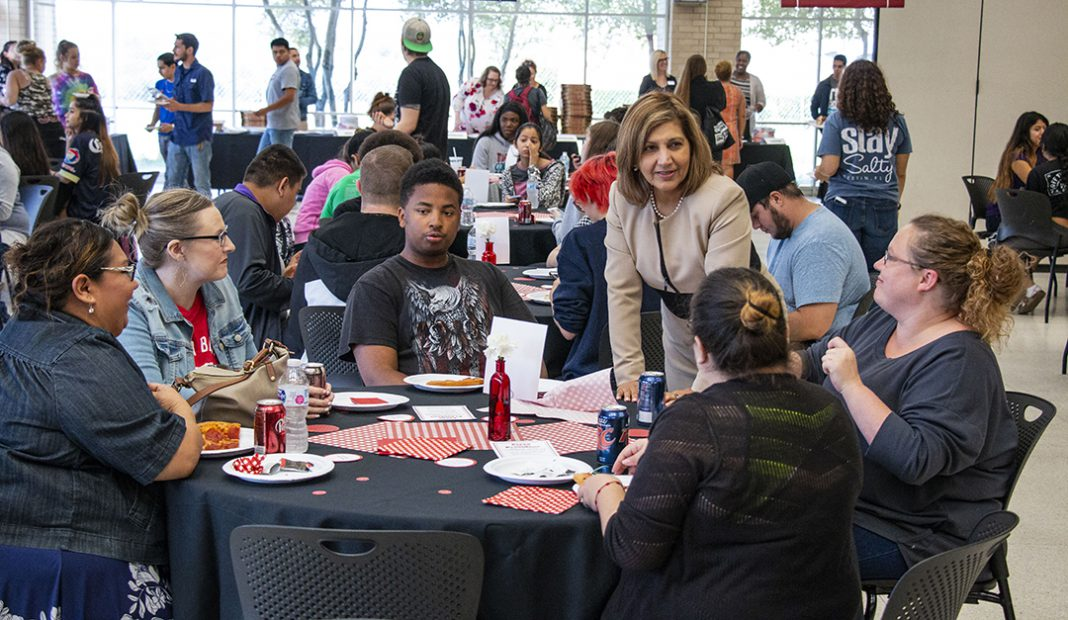 NW president Zarina Blankenbaker talks to students during Pizza with the President Sept. 25 on NW. Blankenbaker walked about to speak with students directly.