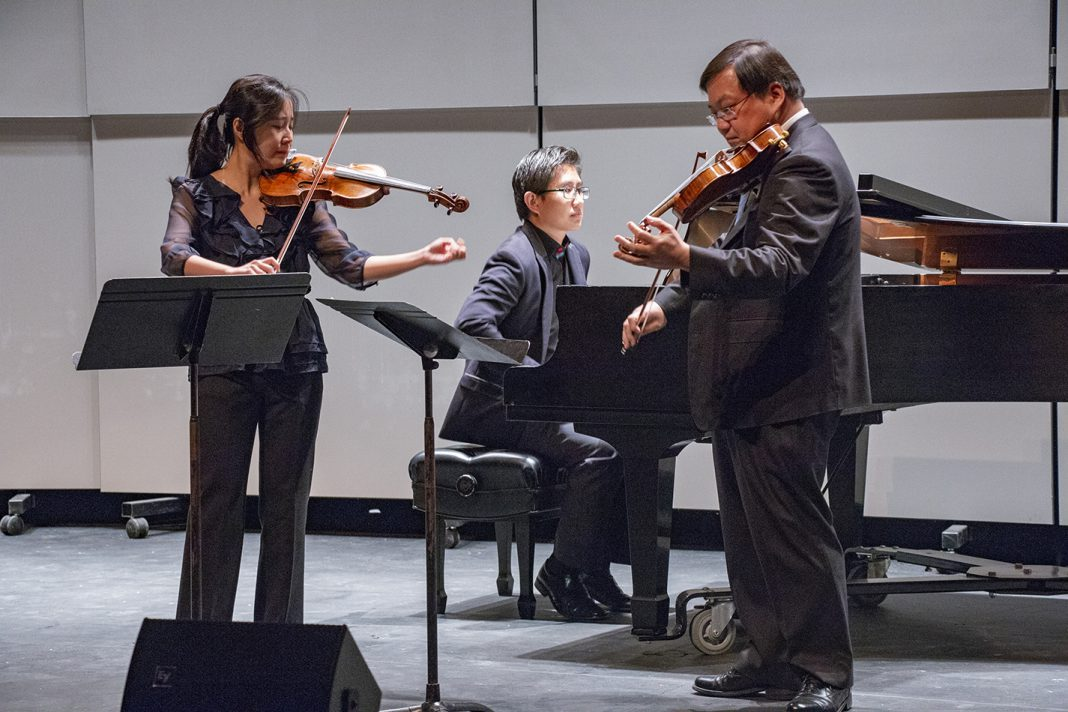 "SE music adjunct instructors Tzu-Ying Chan and Michael Shih perform Johann Sebastian Bach's ""Concerto for Two Violins in D Minor"" during the Faculty Music Recital Oct. 18 in the C.A. Roberson Theatre on SE Campus."