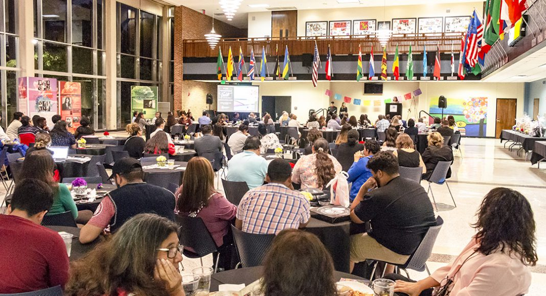 Attendees listen to the keynote speaker at Abrazando al Exito: Embracing Success, which celebrated Hispanic Heritage Month.