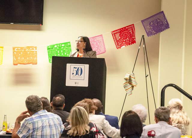 UT San Antonio professor Mariela A. Rodriguez speaks at the Abrazando al Exito scholarship banquet Oct. 9.